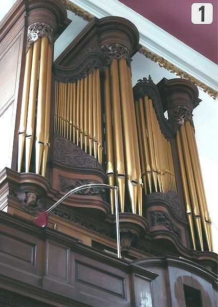 Organ Casework, evidence of white blooming on upper fretwork.